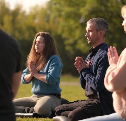 group of people doing yoga qigong and tai chi outside