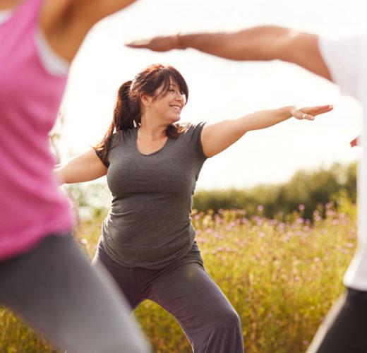 woman doing yoga and qigon outside