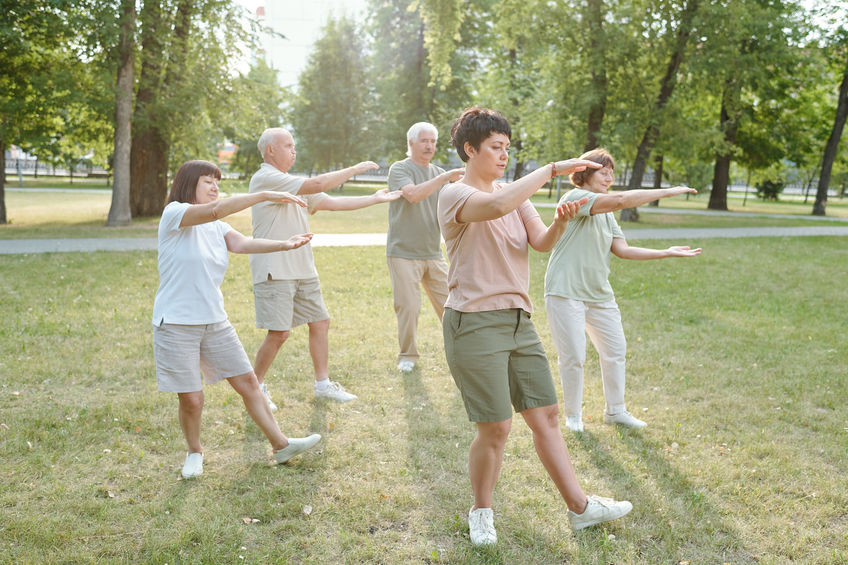 group of people doing qigong outside