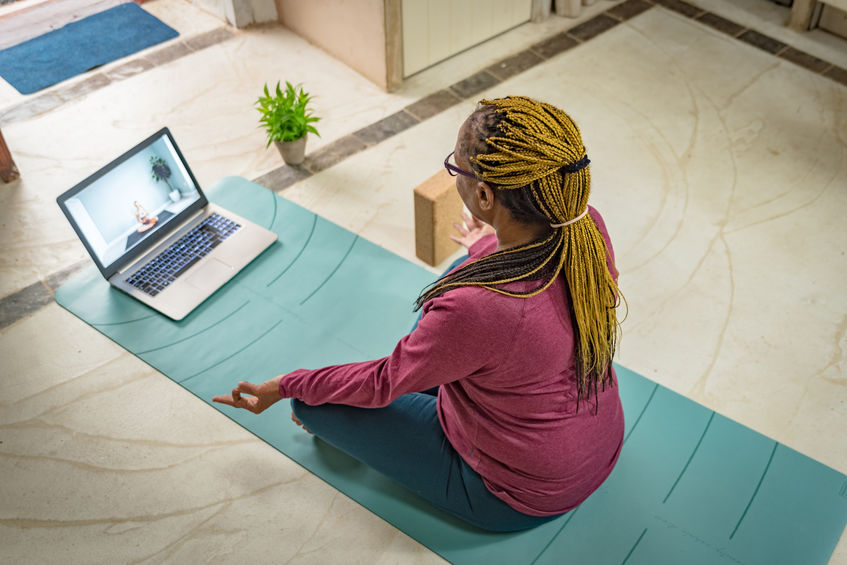 black woman taking online yoga or meditation class